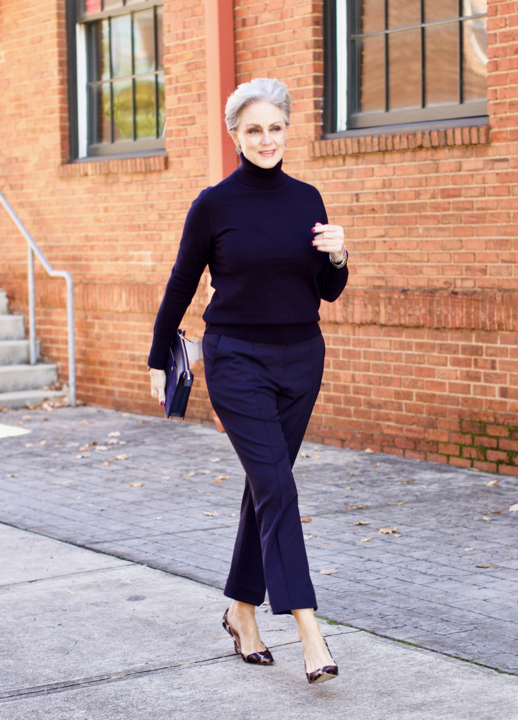 beth from Style at a Certain Age wears an Everlane cashmere turtleneck, Italian weave ankle pants, leopard pumps, and Talbots green overcoat