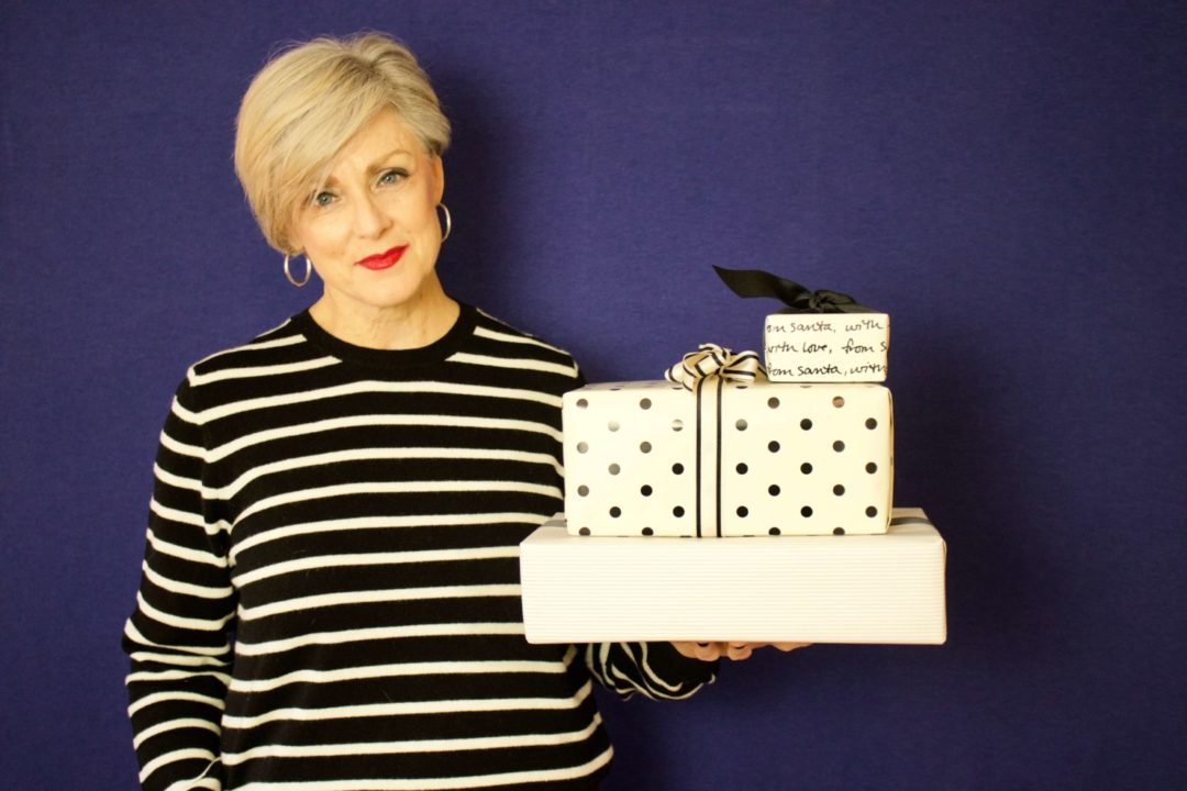 beth from Style at a Certain Age wears a black and white striped cashmere crewneck from Marks & Spencer
