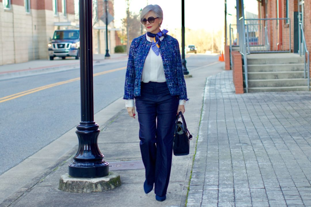 beth from Style at a Certain Age wears an Ann Taylor blue tweed jacket, faux denim sailor pants, v neck button sleeve blouse, silk ribbon chain scarf, and pointy toe booties