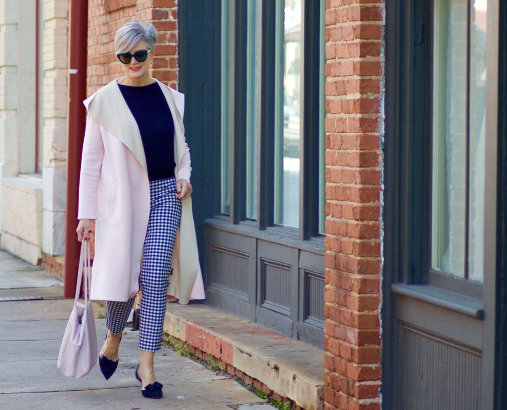 beth from Style at a Certain Age transitions to Spring wearing J.Crew gingham pants, Michael Stars blouson knit top, Misook knit topper and navy suede pumps