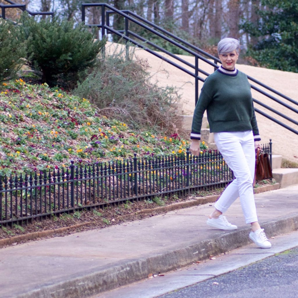 beth from Style at a Certain Age wears a Boden green sweater, white denim and white sneakers