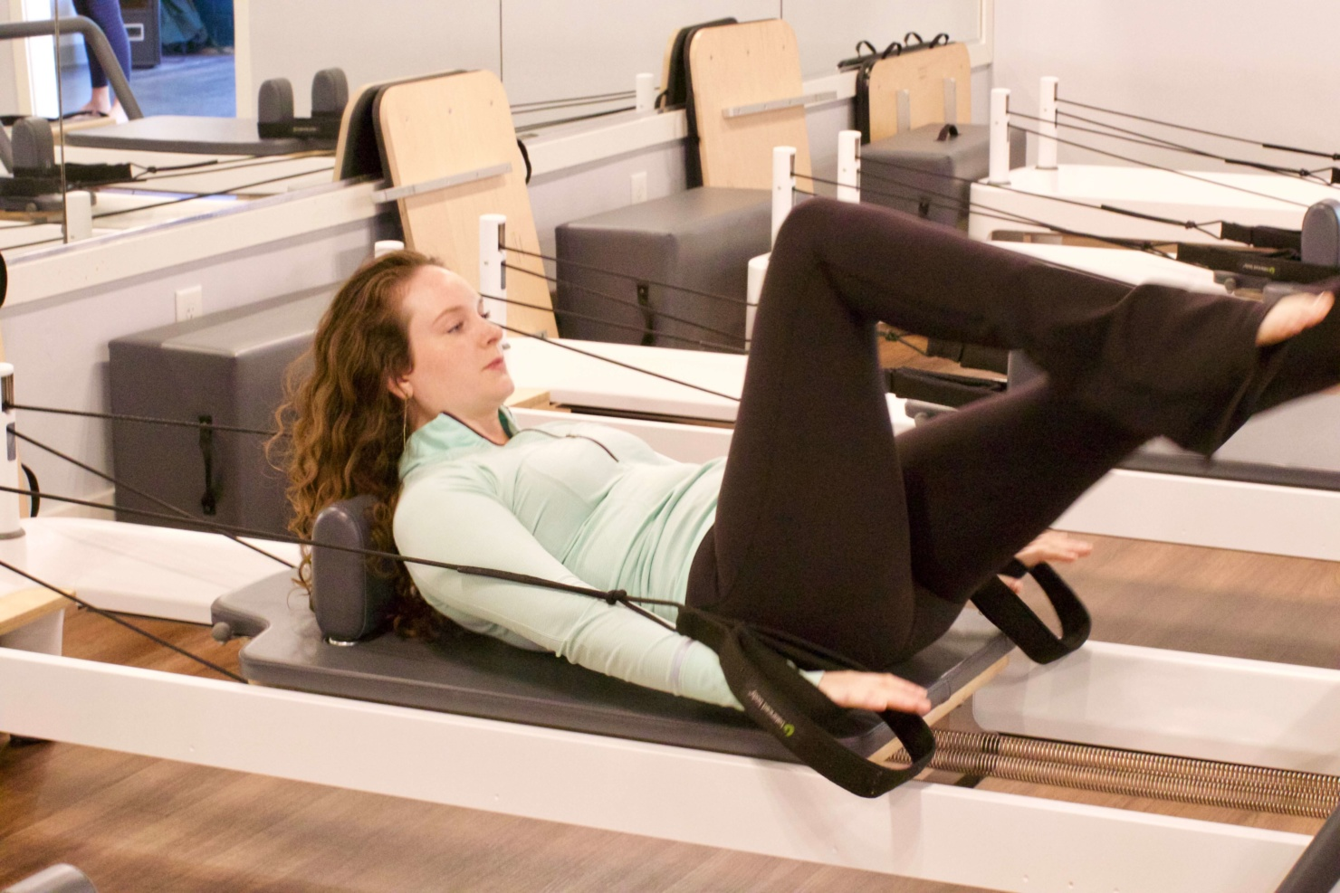 what is a pilates reformer class